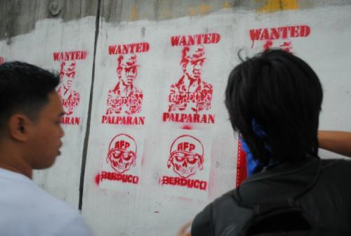 Image of Palparan in stencil being painted by members of rights organizations